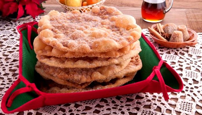 Buñuelo (donuts de noz-pecã e canela com café inglês)